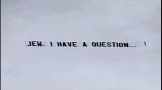 """a banner reading, """"jew i have a question."""""""