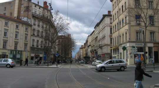 Pedestrians and cars cross Gebrial-Peri Square in Lyon, France on March 28, 2005. (Wikimedia Commons)
