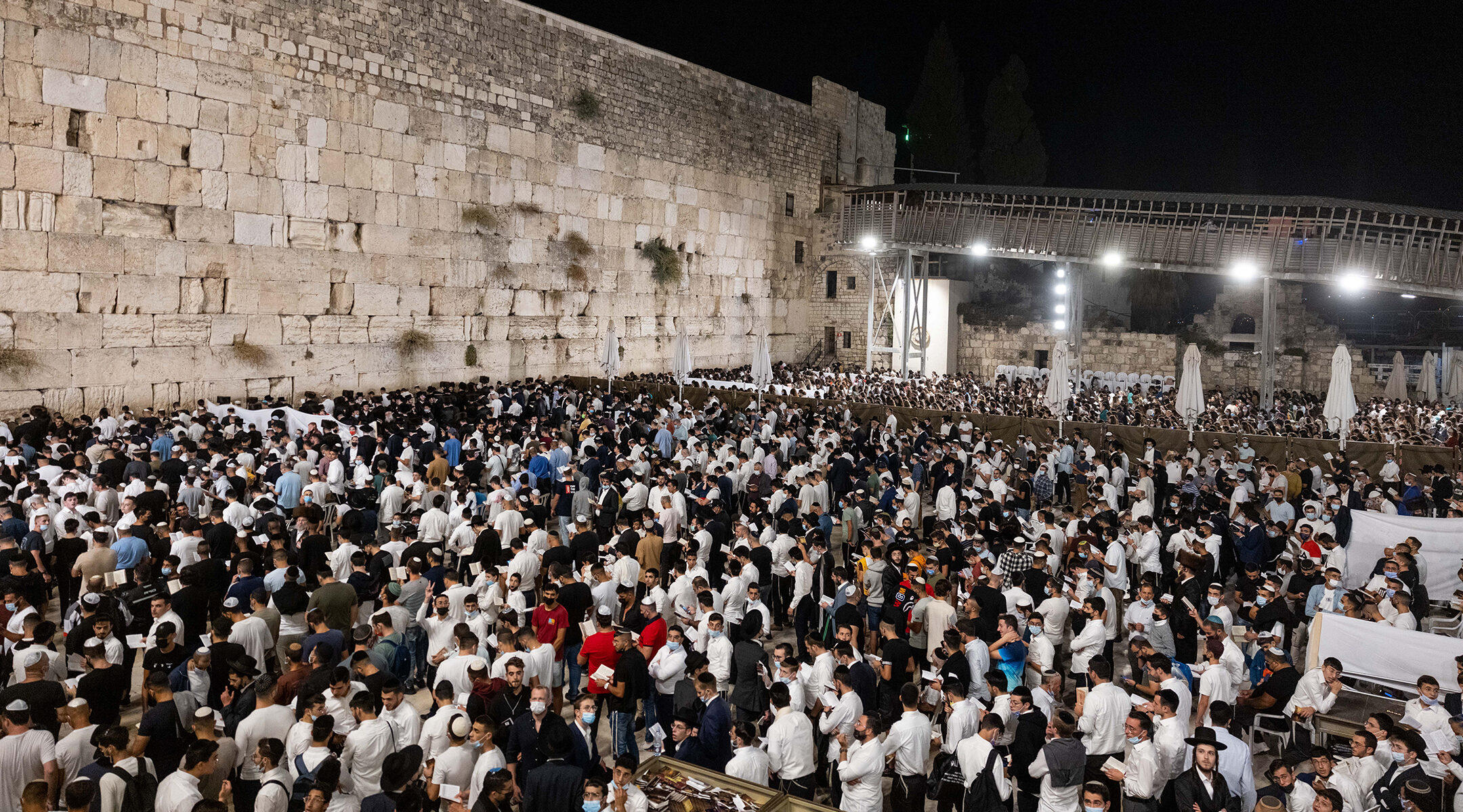 Jews pray for forgivness, or selichot, at the Western Wall in the Old City of Jerusalem on September 5, 2021 (Yonatan Sindel/Flash90)