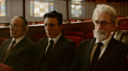 """Three men in a synagogue in the movie """"Minyan"""""""