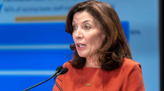New York State Governor Kathy Hochul holds a COVID-19