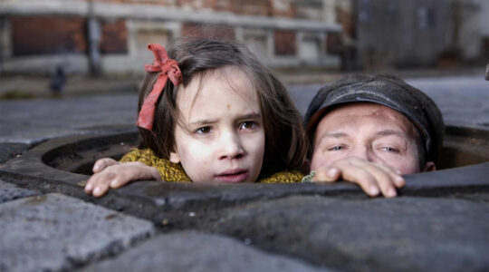 Actors Milla Bankowicz and Robert Wieckiewicz portray members of the Chiger family trying to survive the Holocaust during filming in Lviv, Ukraine in 2011. (Courtesy of Sony Pictures Classics)
