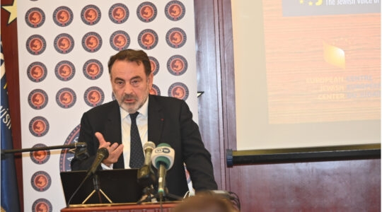 Joel Mergui speaks at a European Jewish Association conference in Brussels, Belgium on Oct. 12, 2021. (Cnaan Liphshiz)